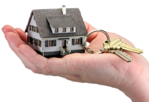 small house keyring with 2 gold keys in palm of hand