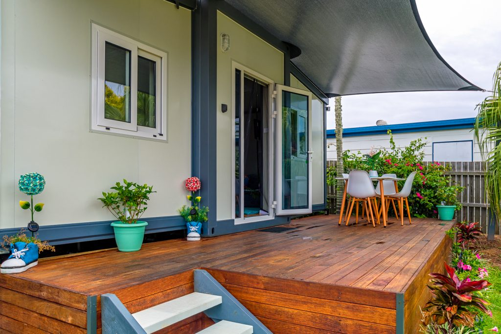 Small Home with verandah and open front door with nice garden and detail