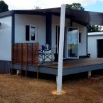 The Moreton - Pop Up Homes Tiny Home - Side view installed with front timber deck