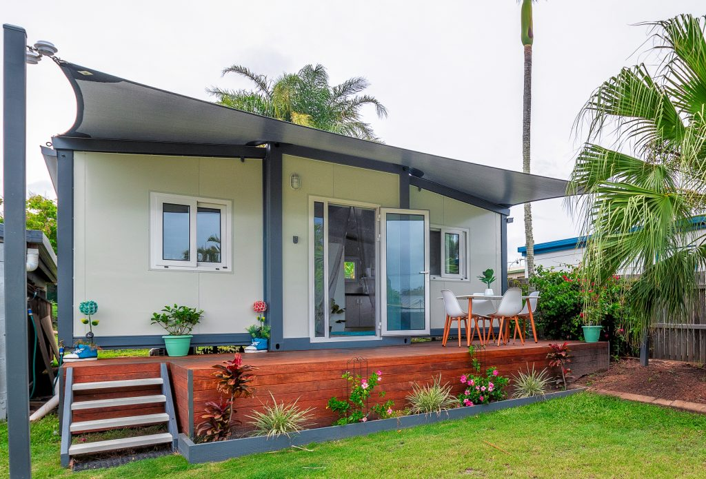 complete small home with awning and deck- landscaped